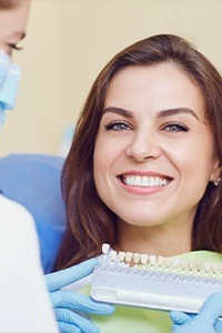 Woman smiling at dentist