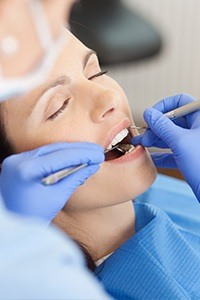 Relaxed patient receiving oral surgery treatment