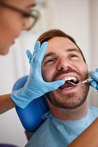 Man receiving dental treatment