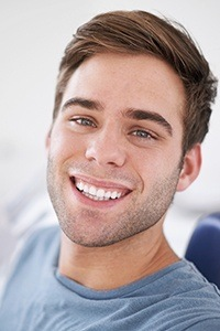 Man in dental chair smiling