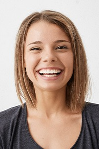 Young woman with healthy aligned smile